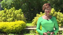 Sharon Momanyi in a green dress. (DW)