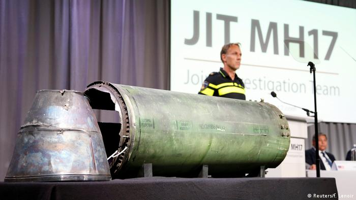 A dmanaged missile is displayed during a press conference by the JIT in the Netherlands