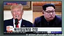 FILE - In this May 11, 2018, file photo, people watch a TV screen showing file footage of U.S. President Donald Trump, left, and North Korean leader Kim Jong Un, right, during a news program at the Seoul Railway Station in Seoul, South Korea. Weeks from his North Korea summit, President Donald Trump is staring down a dealmaker's worst nightmare: overpromising and under-delivering.(AP Photo/Lee Jin-man, File) |