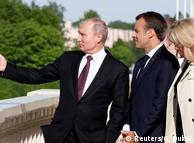 Владимир Путин и Эмманюэль Макрон с женой в Санкт-Петербурге, май 2018 года