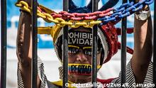 February 24, 2018 - Caracas, Venezuela - A demonstrator seen protesting behind bars during a protest..The NGO Foro Penal (Penal Forum), carried out a street activity for the release of political prisoners and demand justice for the people who died during the protests of the year 2014/2017. .More than 300 people are in prison for protesting against the government of mature nicolas and more than 200 have lost their lives |