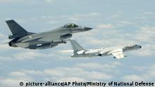 11.05.2018 In this May 11, 2018 photo released by Taiwan's Ministry of National Defense, a Taiwanese Air Force fighter aircraft, left, flies near a Chinese People's Liberation Army Air Force (PLAAF) H6-K bomber that reportedly flew over the Luzon Strait south of Taiwan during an exercise. Taiwan is seeking to build-up its domestic defense industry in the face of China's threats and the reluctance of foreign arms suppliers to provide it with planes, ships, submarines and other hardware to defend its 23 million people. (Ministry of National Defense via AP) |