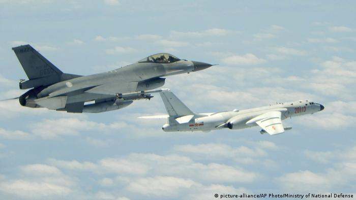 In this May 11, 2018 photo released by Taiwan's Ministry of National Defense, a Taiwanese Air Force fighter aircraft, left, flies near a Chinese People's Liberation Army Air Force (PLAAF) H6-K bomber that reportedly flew over the Luzon Strait south of Taiwan during an exercise