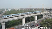 A metro train runs on an elevated railway line during a trial run undertaken ahead of the opening of the Indian Hyderabad Metro Rail (HMR) project in Hyderabad on November 24, 2017. Prime Minister Narendra Modi will inaugurate the first phase of the Hyderabad Metro Rail project on November 28. / AFP PHOTO / NOAH SEELAM (Photo credit should read NOAH SEELAM/AFP/Getty Images)
