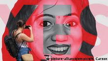 Ireland abortion laws. A woman photographs a mural of Savita Halappanavar in Dublin, as Ireland goes to the polls to vote in the referendum on the 8th Amendment of the Irish Constitution. Picture date: Friday May 25, 2018. See PA story IRISH Abortion. Photo credit should read: Niall Carson/PA Wire URN:36689745 |