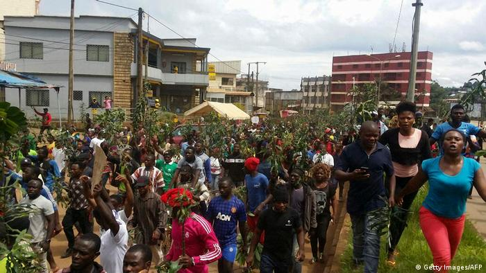 emonstrators march during a protest against perceived discrimination in favour of the country's francophone majority