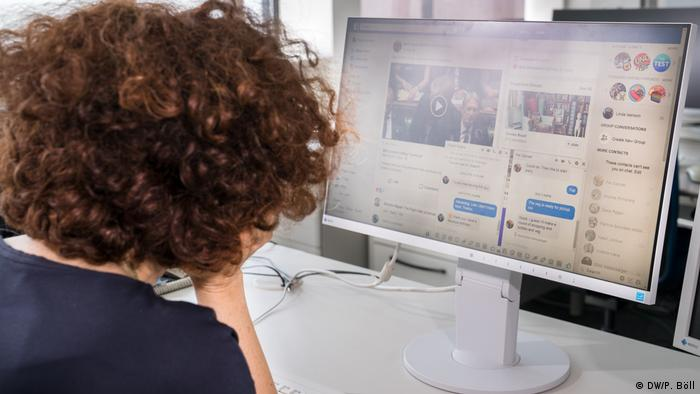 Woman in front of screen