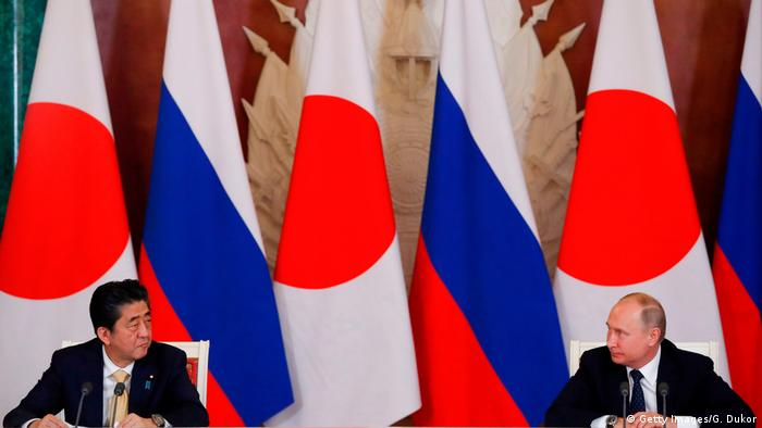 Japan's Shinzo Abe and Russia's Vladimir Putin at their joint press conference