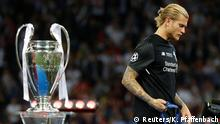 Soccer Football - Champions League Final - Real Madrid v Liverpool - NSC Olympic Stadium, Kiev, Ukraine - May 26, 2018 Liverpool's Loris Karius walks past the trophy with his medal after the match REUTERS/Kai Pfaffenbach