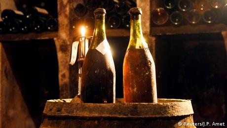 Two bottles of vin jaune yellow wine from 1774 presented in the cellar in Arbois, France before the auction