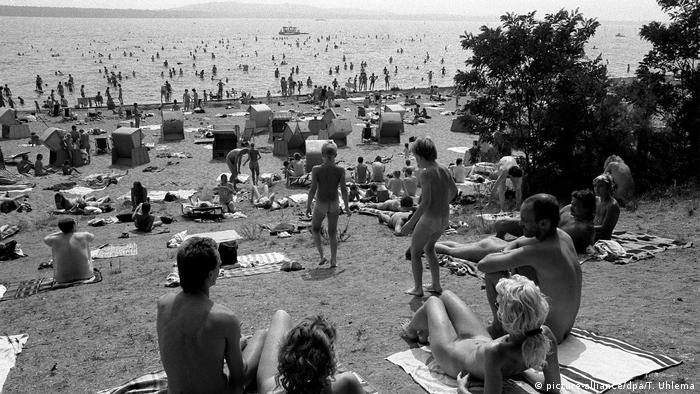 nudists bask in the sun at Müggelsee, East Berlin. (picture-alliance/dpa/T. Uhlema)
