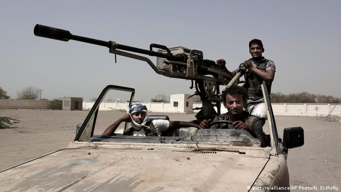 Pro-government fighters patrol near Hodeida