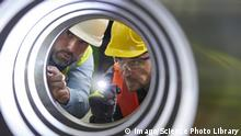Serious engineers examining steel pipe Serious male engineers with flashlights examining steel pipe PUBLICATIONxINxGERxSUIxHUNxONLY CAIAxIMAGE/SCIENCExPHOTOxLIBRARY F020/1984