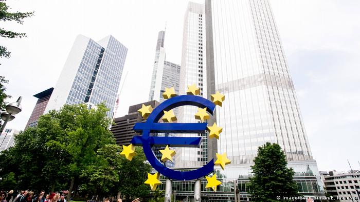 Frankfurt's banking district with a euro symbol
