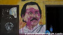 07.05.2018 A mural of Nicaraguan President Daniel Ortega stands defaced at a campaign house for the Sandinista National Liberation Front (FSLN) in Catarina, Nicaragua, Monday, May 7, 2018, the morning after anti-government demonstrators clashed with FSLN supporters and police. Protests in which dozens of people were killed amid a harsh crackdown by police and government-allied civilians have weakened Ortega, one of the few leftist leaders remaining in power in Latin America, forcing him to pull back on social security reforms that sparked the unrest and facing a newly emboldened opposition determined to see him leave office. (AP Photo/Moises Castillo) |