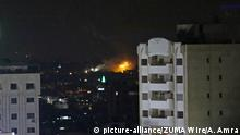 30.05.2018 May 30, 2018 - Gaza City, Gaza Strip, Palestinian Territory - A picture taken from Gaza City on May 30, 2018, shows a fire and smoke billowing in the background following an Israeli air strike on the Palestinian enclave. The Israeli Defense Forces (IDF) said it launched more than 35 airstrikes targeting the militant groups Hamas and Islamic Jihad, after approximately 70 rockets and mortars were fired toward Israeli territory Tuesday morning |
