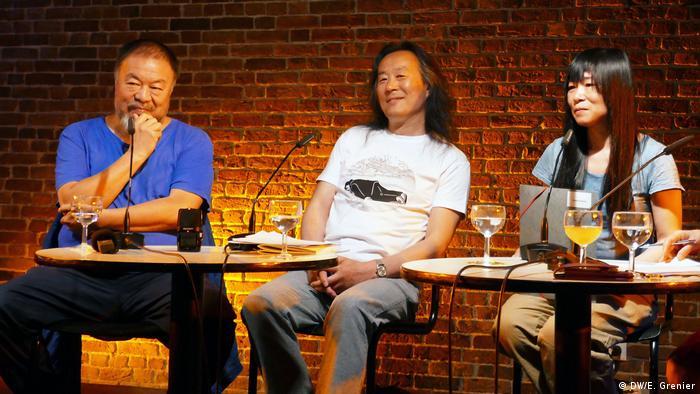 left to right, Ai Weiwei, Yang Lian and Zheng Xiaoqiong