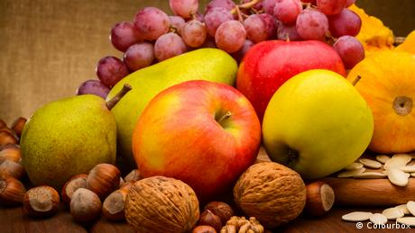 A mix of apples, pears, grapes and nuts.