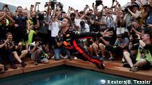 Formula One F1 - Monaco Grand Prix - Circuit de Monaco, Monte Carlo, Monaco - May 27, 2018 Red Bull's Daniel Ricciardo jumps into a pool as he celebrates winning the race REUTERS/Benoit Tessier TPX IMAGES OF THE DAY