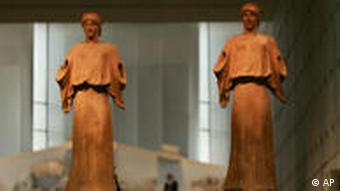 Two 2,300-year-old terracotta sculptures of the ancient goddess of victory, Nike, are displayed in the new Acropolis Museum in Athens, Greece, on Wednesday, June 17, 2008. Greece's Orthodox Church on Wednesday formally blessed the new museum, which is scheduled to open this weekend. Greek officials hope one day to display the British Museum's Elgin Marbles from the Acropolis in the glass and concrete museum despite repeated refusals from London. (AP Photo/Petros Giannakouris