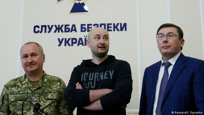 Russian journalist Arkady Babchenko at a press conference in Kyiv Wednesday, flanked by Vasily Gritsak (l) head of Ukraine's SBU security services and Yuriy Lutsenko (r) Ukraine's prosecutor general