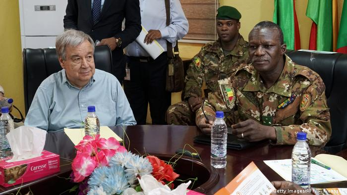 UN Secretary General Guterres seated at a table with G5 Sahel Force Commander Didier Dacko.