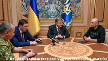 Ukrainian President Petro Poroshenko meets with Russian journalist Arkady Babchenko, who was declared murdered and then later turned up alive, Prosecutor General Yuriy Lutsenko and head of the state security service (SBU) Vasily Gritsak in Kiev, Ukraine May 30, 2018. Mykola Lazarenko/Ukrainian Presidential Press Service/Handout via REUTERS ATTENTION EDITORS - THIS IMAGE WAS PROVIDED BY A THIRD PARTY.