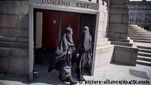 Women in niqab exit the audience seats in the Danish Parliament at Christiansborg Castle in Copenhagen, Denmark, Thursday May 31. 2018. A majority in the Danish Parliament adopted Thursday a ban wearing niqab or burka in public. |