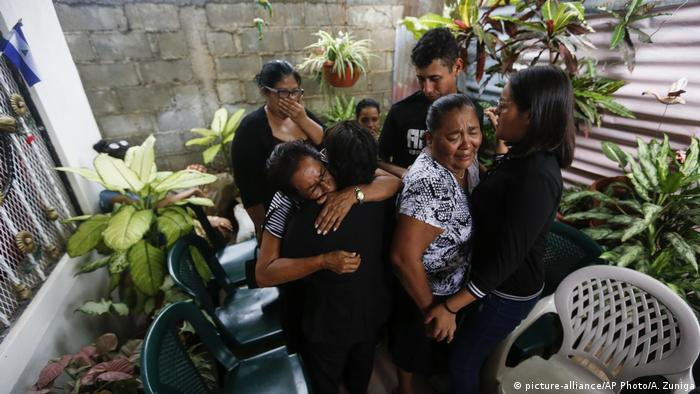 Family members of Francisco Javier Reyes weep at a wake following his death