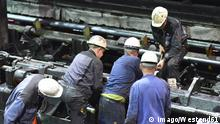 Workers doing maintenance works in a tube rolling mill property released PUBLICATIONxINxGERxSUIxAUTxHUNxONLY SCH000192 Workers Doing Maintenance Works in a Tube Rolling Mill Property released PUBLICATIONxINxGERxSUIxAUTxHUNxONLY SCH000192