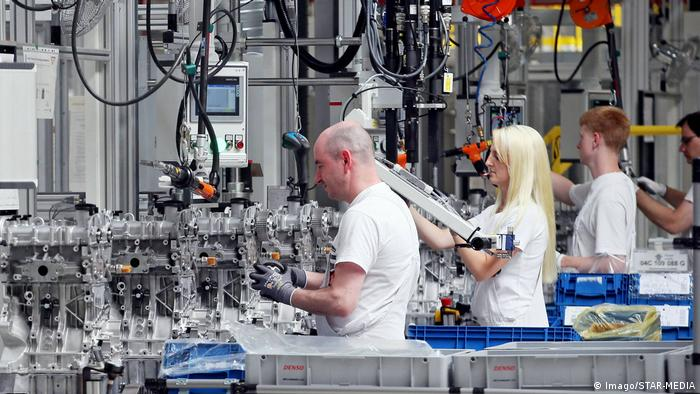 People work in a factory in Germany