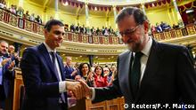 Spain's new Prime Minister and Socialist party (PSOE) leader Pedro Sanchez shakes hands with ousted Prime Minister Mariano Rajoy after a motion of no confidence vote at parliament in Madrid, Spain, June 1, 2018. Pierre-Philippe Marcou/Pool via REUTERS