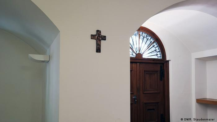 A cross hangs near the entryway of Bavaria's Ministry for Education, Science and Art in Munich, Germany