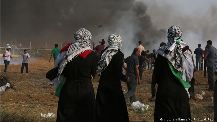 Palestinian protesters near where a volunteer medic was shot dead