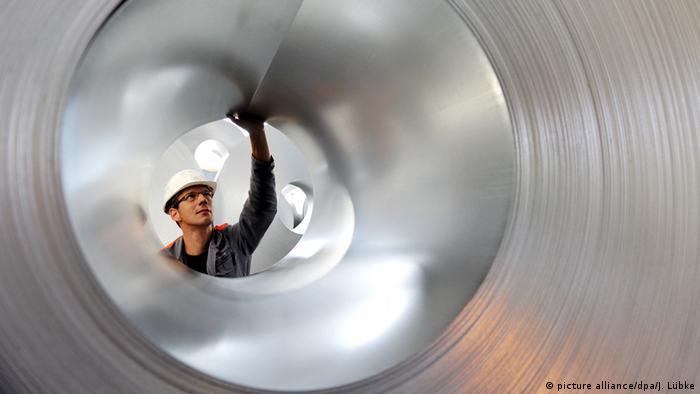 engineer inspecting an aluminium tube