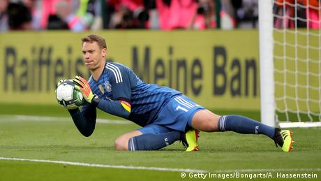 Manuel Neuer catching the ball in front of the goal in Klagenfurt, Austria (Getty Images/Bongarts/A. Hassenstein)