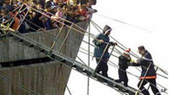 People board a ship