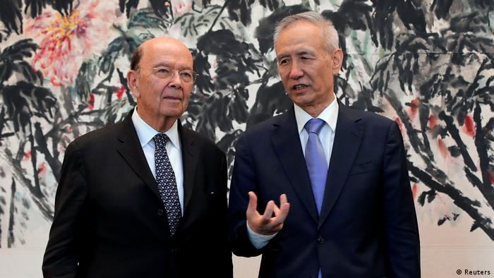 Chinese Vice Premier Liu He (right) in June last year with US Secretary of Commerce Wilbur Ross
