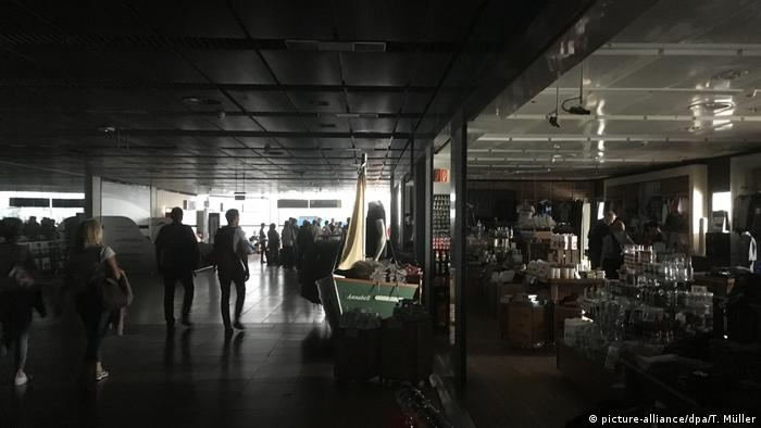 A terminal at Hamburg Airport is plunged into darkness