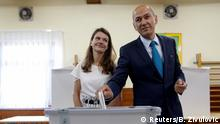 Janez Jansa, leader of the Social Democratic Party (SDS), and his wife Urska cast their votes at a polling station during the general election in Velenje, Slovenia, June 3, 2018. REUTERS/Borut Zivulovic