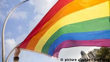 21.07.2017 A participant is holding the pride flag during the Dyke March. Hundreds participate in the 5th Dyke March in Berlin organized as part of the city's Pride Week events, July 21, 2017. The marchers made their way from Platz Der Luftbruke throughout the city's Kreuzberg district waving pride rainbow flags and signs in support of the LGBTQ community.***ISRAEL OUT*** (Photo by Omer Messinger/NurPhoto) | Keine Weitergabe an Wiederverkäufer.