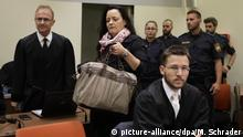 05.06.2018 Terror suspect Beate Zschaepe, center, arrives in the court room in Munich, Germany, Tuesday, June 5, 2018. Zschaepe has been on trial since May 2013 as an alleged accomplice in a series of racially motivated murders by a neo-Nazi terrorist cell of the so-called National Socialist Underground (NSU) across Germany. (AP Photo/Matthias Schrader, Pool)  
