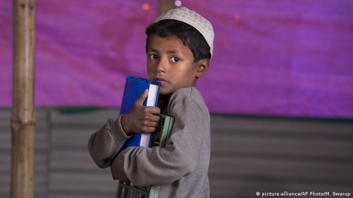 A young boy visits a makeshift school in a mosque in Bangladesh