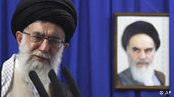 Iran's Supreme Leader Ayatollah Ali Khamenei, delivers his sermon in front of a picture of the late spiritual leader Ayatollah Khomeini, during the Friday prayers, at the Tehran University campus, in Tehran, Iran, Friday, June 19, 2009.