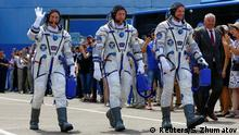 International Space Station (ISS) crew members Serena Aunon-Chancellor of the U.S, Alexander Gerst of Germany and Sergey Prokopyev of Russia walk after donning space suits shortly before their launch at the Baikonur Cosmodrome, Kazakhstan June 6, 2018. REUTERS/Shamil Zhumatov