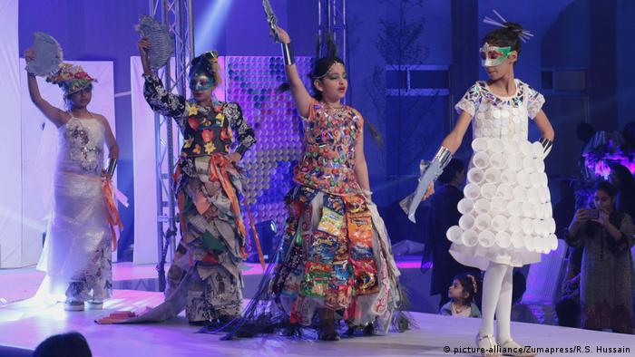 Models wear dress made from plastic at a fashion show
