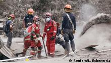 05.06.2018 Rescue workers remove ash at an area affected by the eruption of the Fuego volcano in the community of San Miguel Los Lotes in Escuintla, Guatemala June 5, 2018. REUTERS/Luis Echeverria