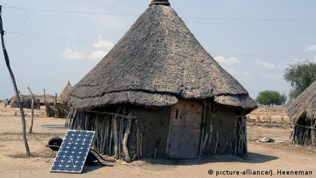 A hut with a solar panel in South Sudan