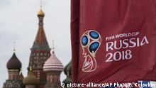 FILE - In this June 4, 2018, file photo, a flag with the logo of the World Cup 2018 on display with the St. Basil's Cathedral in the background, in Moscow, Russia. Well-known Russian singer Julia Chicherina, who was scheduled to perform on June 15, 2018, said FIFA barred her from performing at the World Cup because of her support for Russia-backed rebels in eastern Ukraine. (AP Photo/Pavel Golovkin, File) |