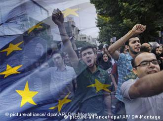 Iranian protestors and an EU flag.
